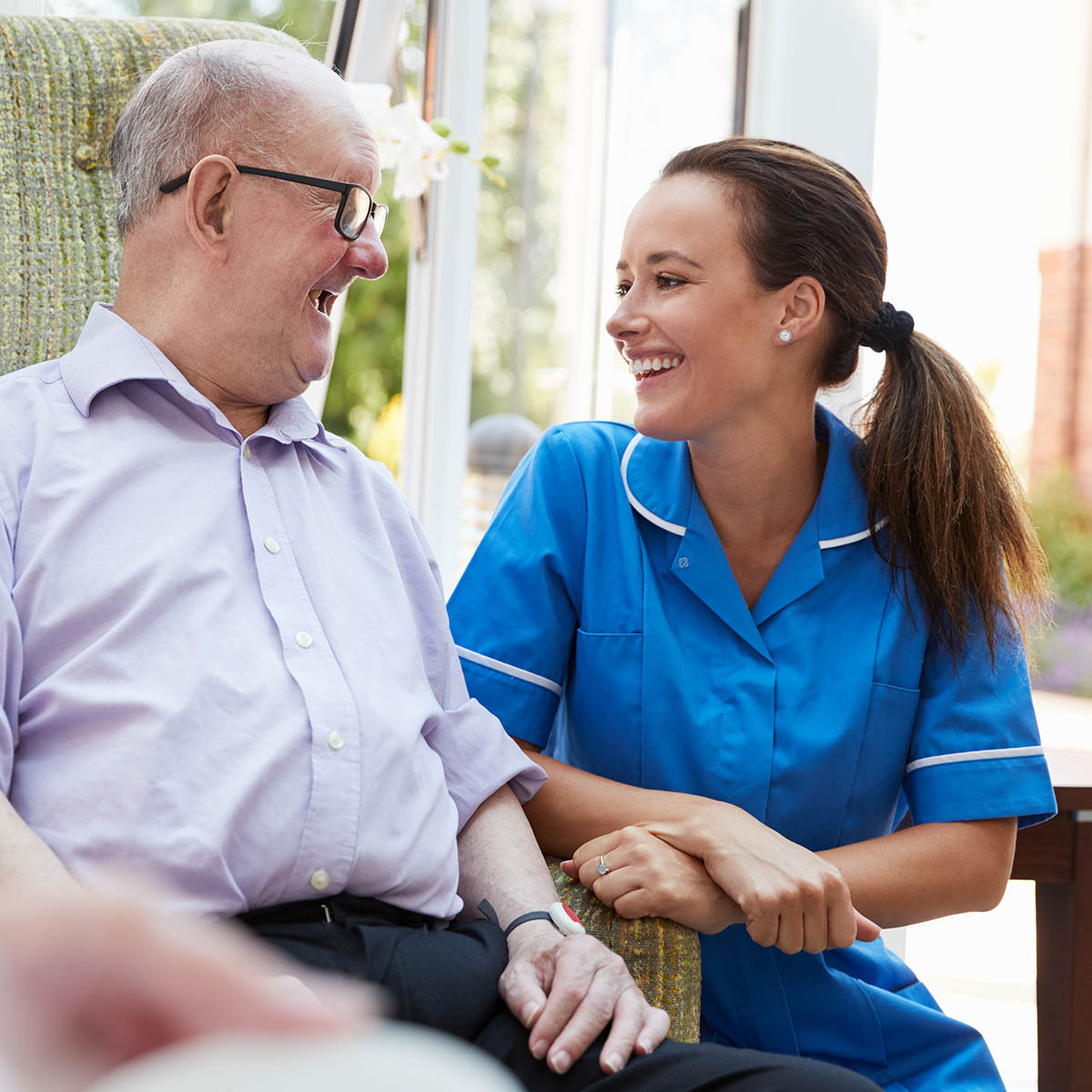 Care home nurse with elderly patient